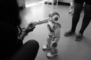Photo 3: The robot NAO, developed by Softbank Robotics, is an interactive and personalized robot already tested for educational and therapeutic purposes. Source: Glenda Hannibal