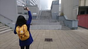 Person photographing Donau Citys sights