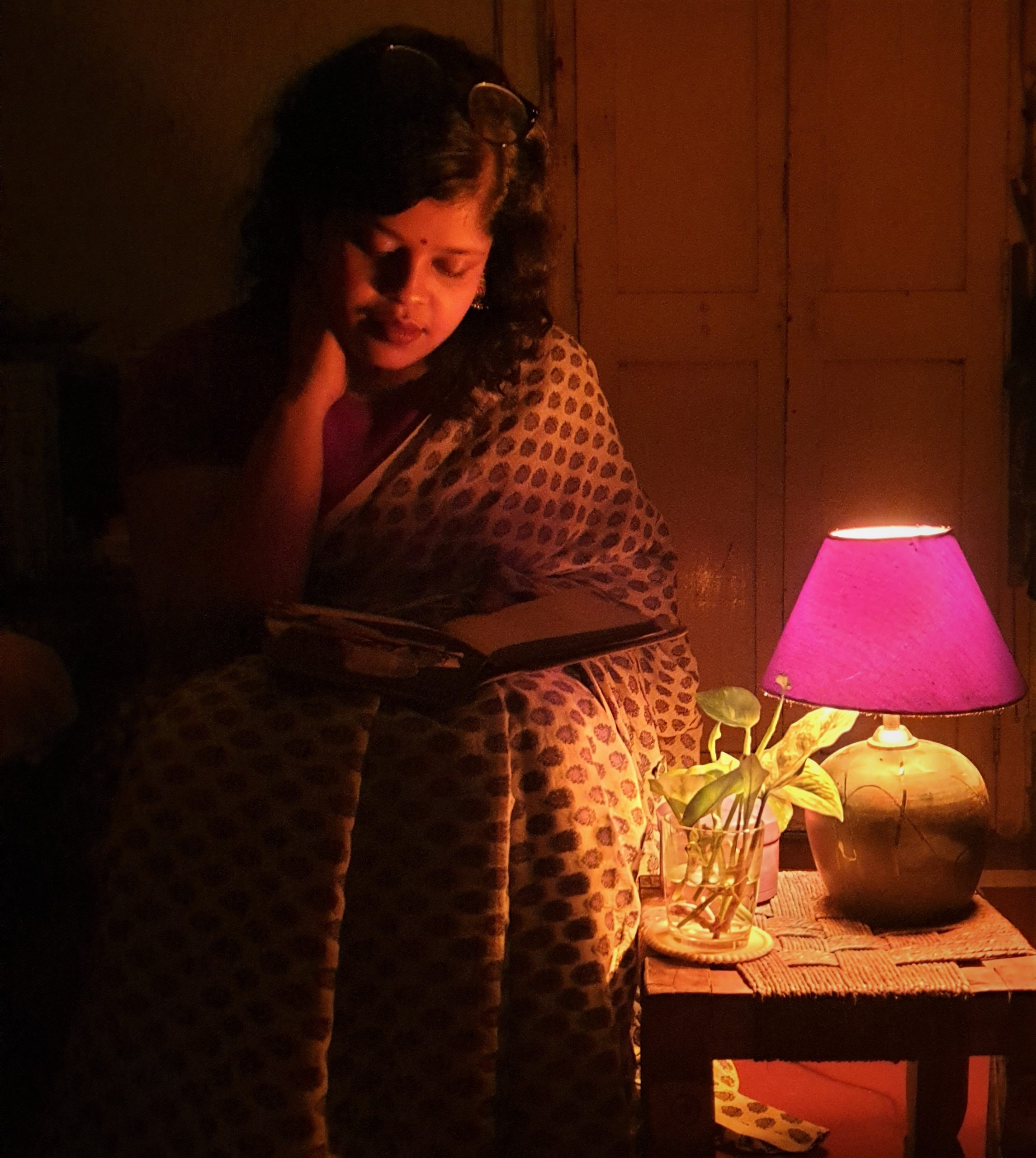 Sohini is reading a book.